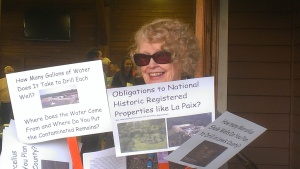 Myra Bonhage-Hale holds signs with questions she had for Console