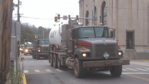 A convoy of fracking industry trucks rumble through Weston, W.Va. at lunchtime