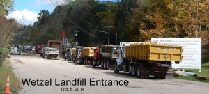 Trucks hauling solid waste from fracking sites line up at the Wetzel County landfill. Photo by Bill Hughes