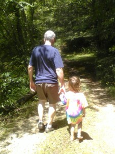 Granddaughter and Grandpa enjoy a walk in the woods
