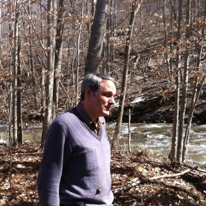 Joao Barroso stands along Mill Creek on his property