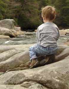 A child enjoys the wonder of a Wild West Virginia river. Photo courtesy of West Virginia Rivers Coalition