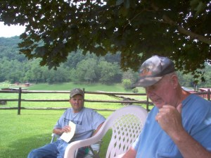 Justin McClain (L) listens as his father, Robert talks about the Stonewall Gas Gathering Pipeline