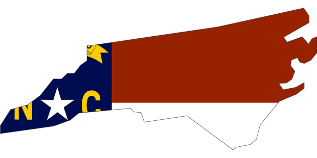 NC outline and flag